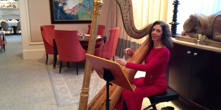 Harpist performing for Holiday Teas at St. Regis Atlanta